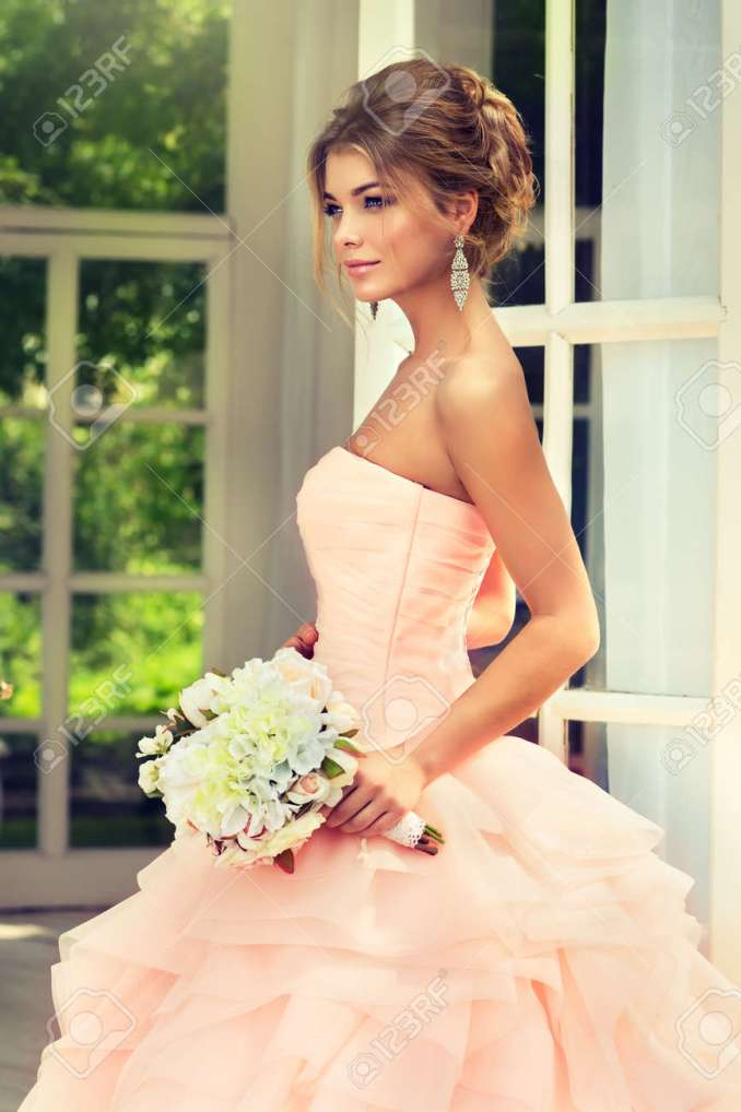 fashionable bride in gorgeous and posh wedding gown with wedding..