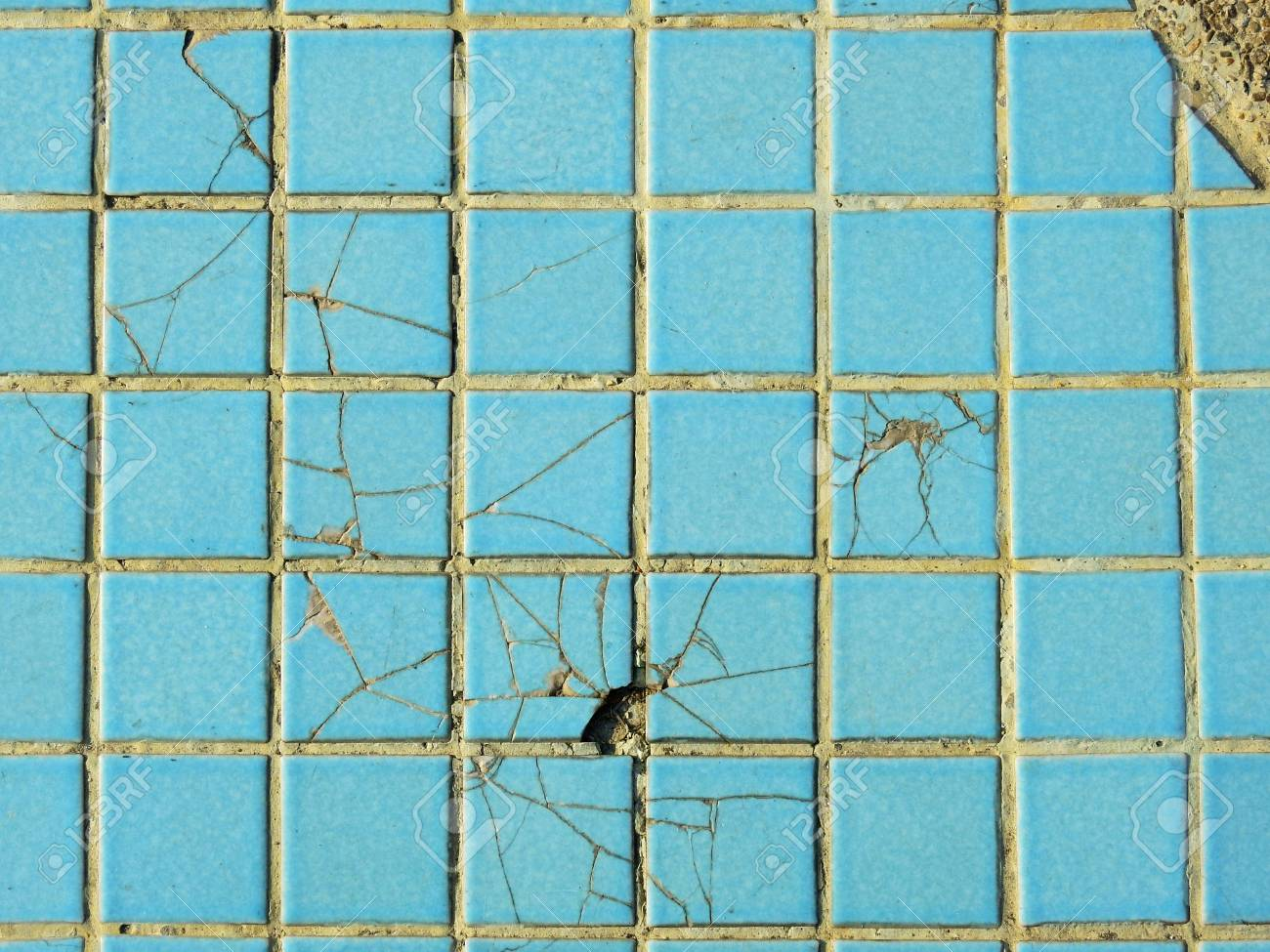 old blue ceramic tile floor with crack texture