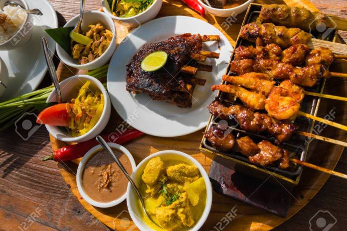 Traditional Balinese Sea Food With Satay And Curry In Bali Indonesia Stock Photo Picture And Royalty Free Image Image 87256264