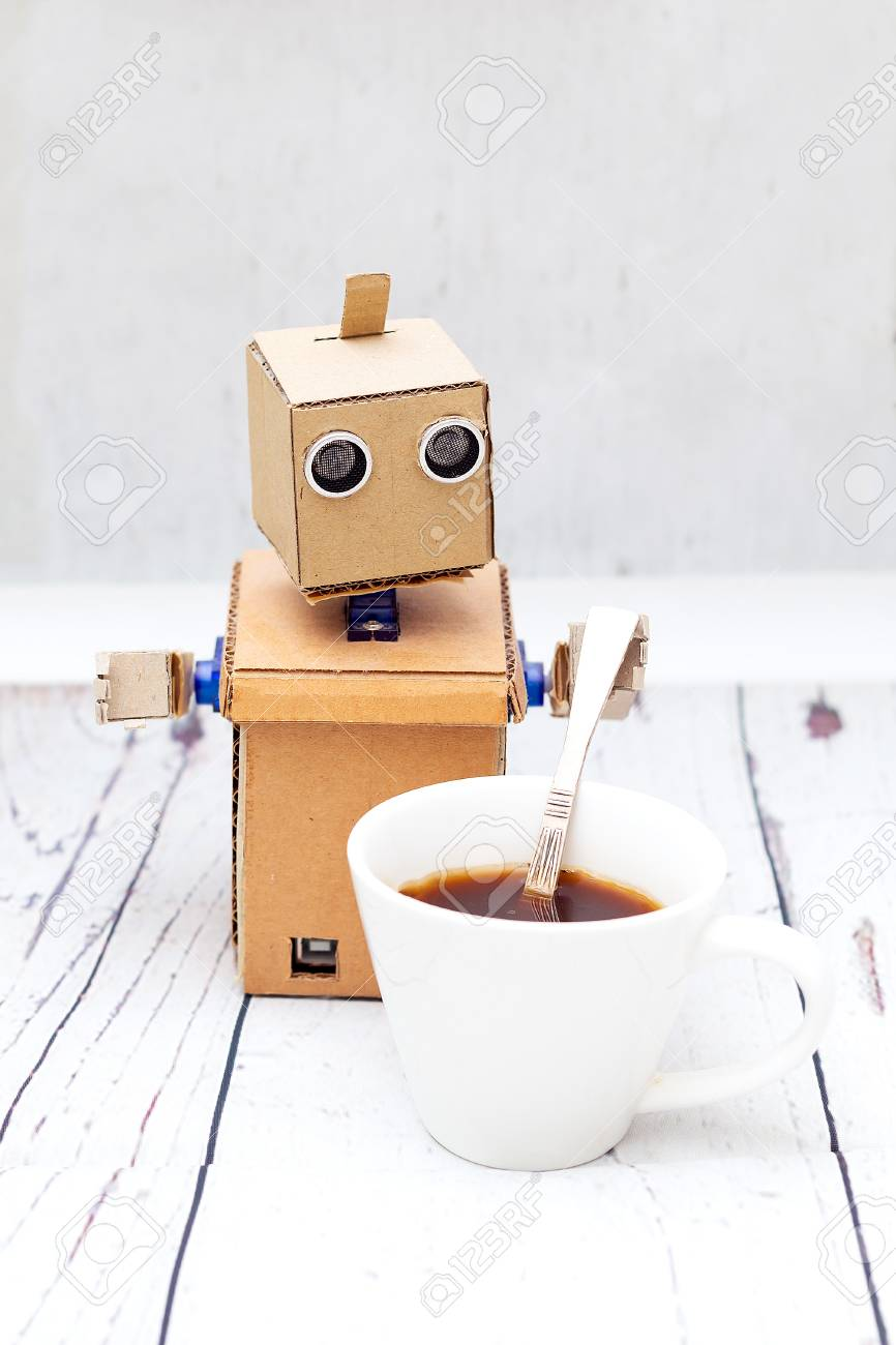 robot holding a spoon