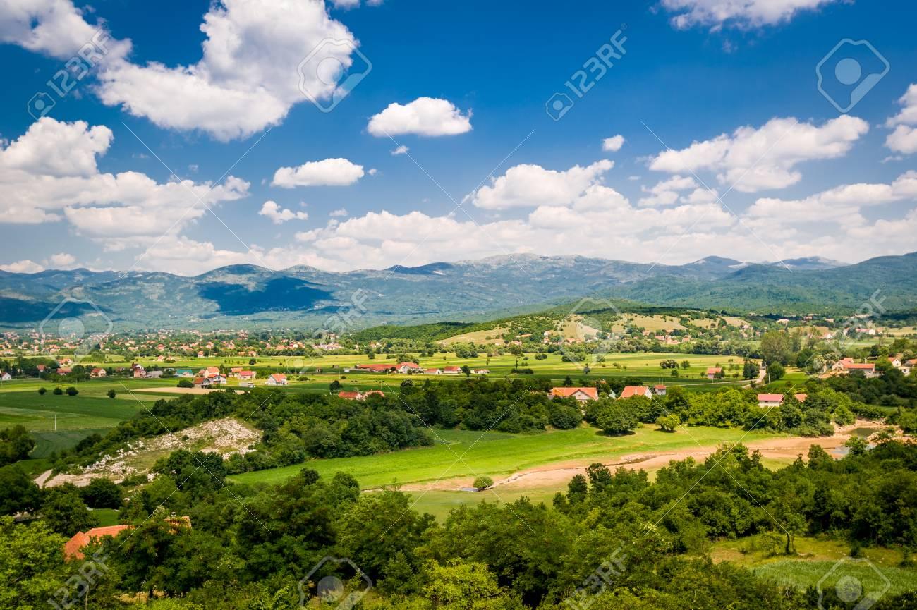 hight resolution of foto de archivo paisaje rural de montenegro t pico casas de campo en los campos peque o r o y la sierra en un fondo niksic montenegro