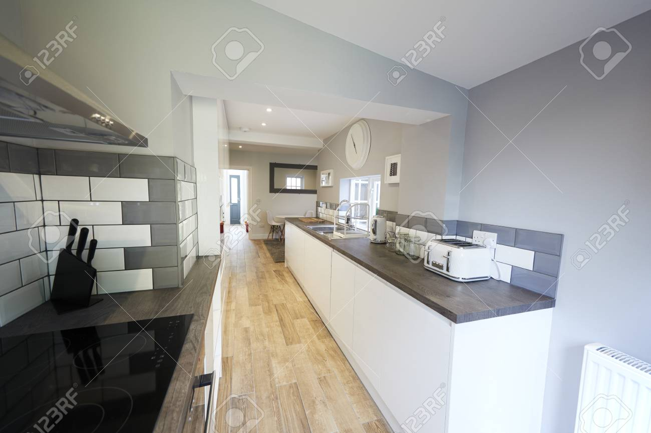 Kitchen In Newly Decorated House Looking Towards Front Door Stock Photo Picture And Royalty Free Image Image 123081391