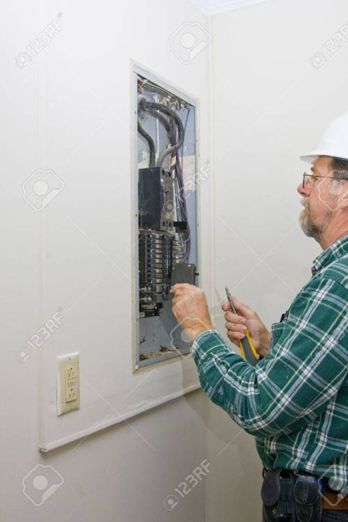 small resolution of inspector hired by future home owner checking circuit breakers for loose connections defective breakers