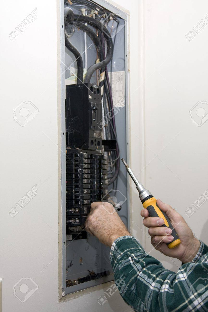 hight resolution of inspector hired by future home owner checking circuit breakers for loose connections defective breakers