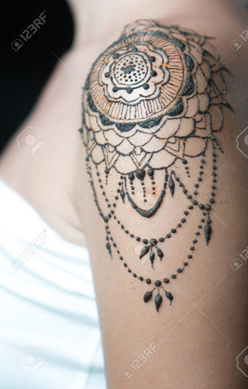 Closeup Freshly Done Henna Tattoo On Womans Shoulder Stock Photo