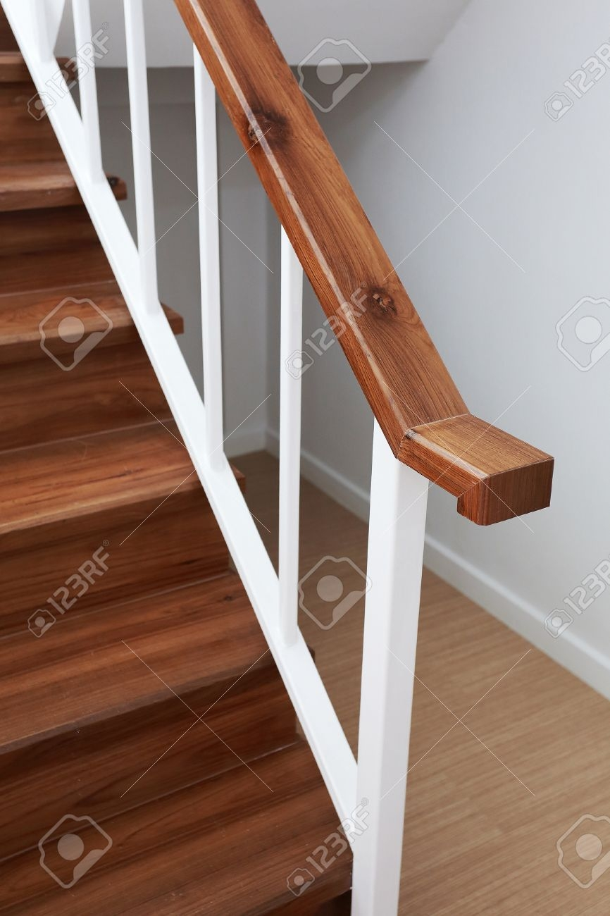 Wooden Staircase Railing In A White Modern House Stock Photo | Modern Wood Staircase Railing | Interior | Stylish | Wall Mounted | Contemporary | House