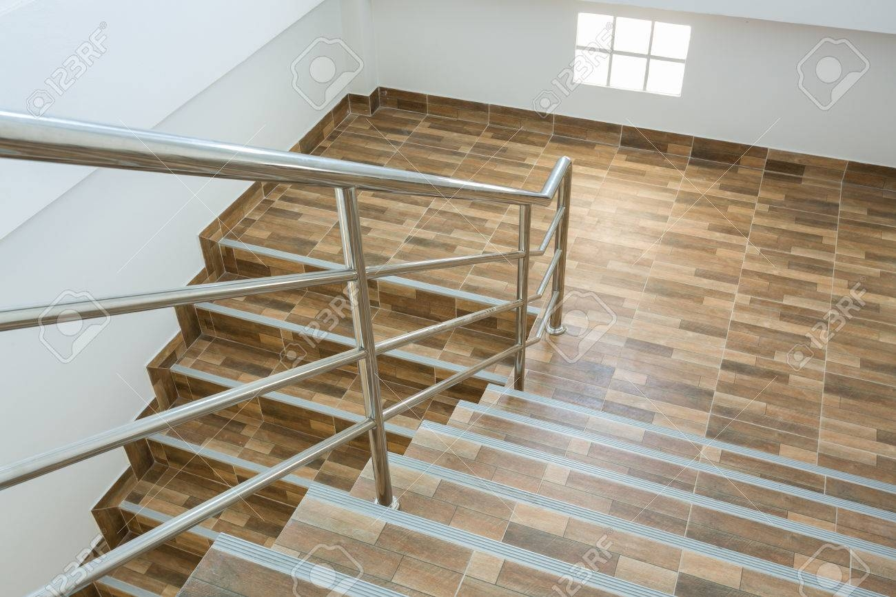 Staircase In Residential House With Stainless Steel Banister   Wood And Steel Handrail   Wood Framed   Interior   Round   Rustic   Glass