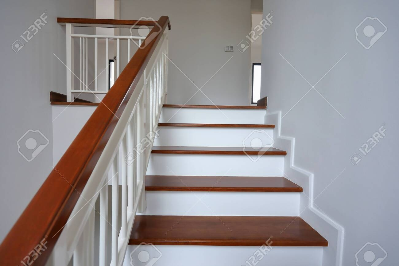 Brown Wooden Stair With White Steel Balustrade And Hardwood   Modern Wood Stair Railing   Wrought Iron   Staircase Railing   Modern Style   Deck   Horizontal Bar