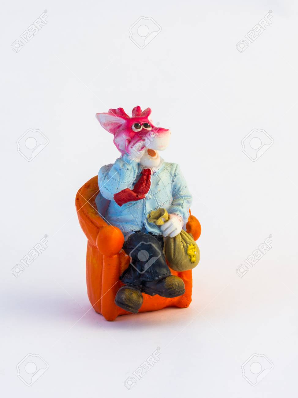 Dragon Chair Figurine Of A Dragon In A Suit Sitting On An Orange Chair With