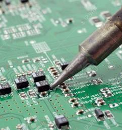 technician repairing electronic circuit board with soldering stock rh 123rf com steam iron circuit board soldering iron temperature circuit board [ 1300 x 866 Pixel ]