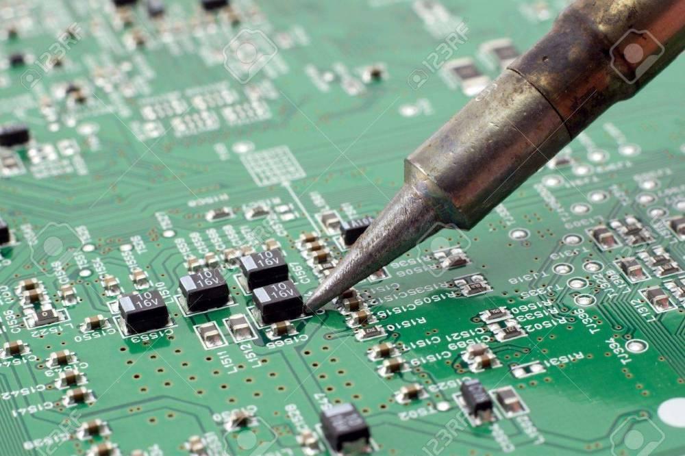 medium resolution of technician repairing electronic circuit board with soldering stock rh 123rf com steam iron circuit board soldering iron temperature circuit board