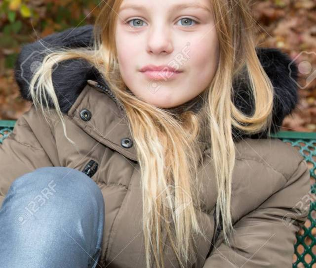 Cute Blonde Teen Girl Smilingon The Bench Autumn Stock Photo Jpg 866x1300 Pretty Blonde Teens With