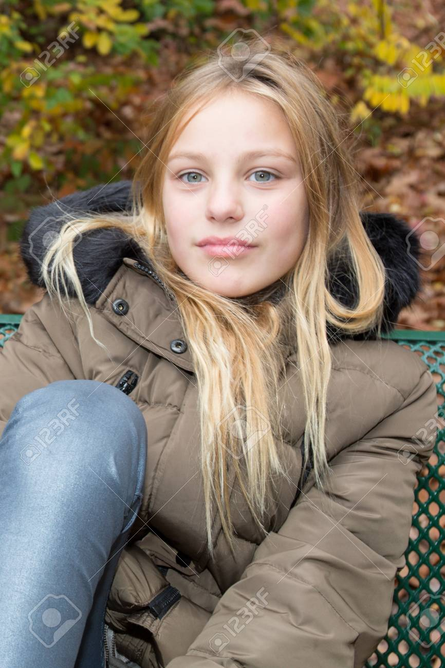 Cute Blonde Teen Girl Smilingon The Bench Autumn Stock Photo 66146856