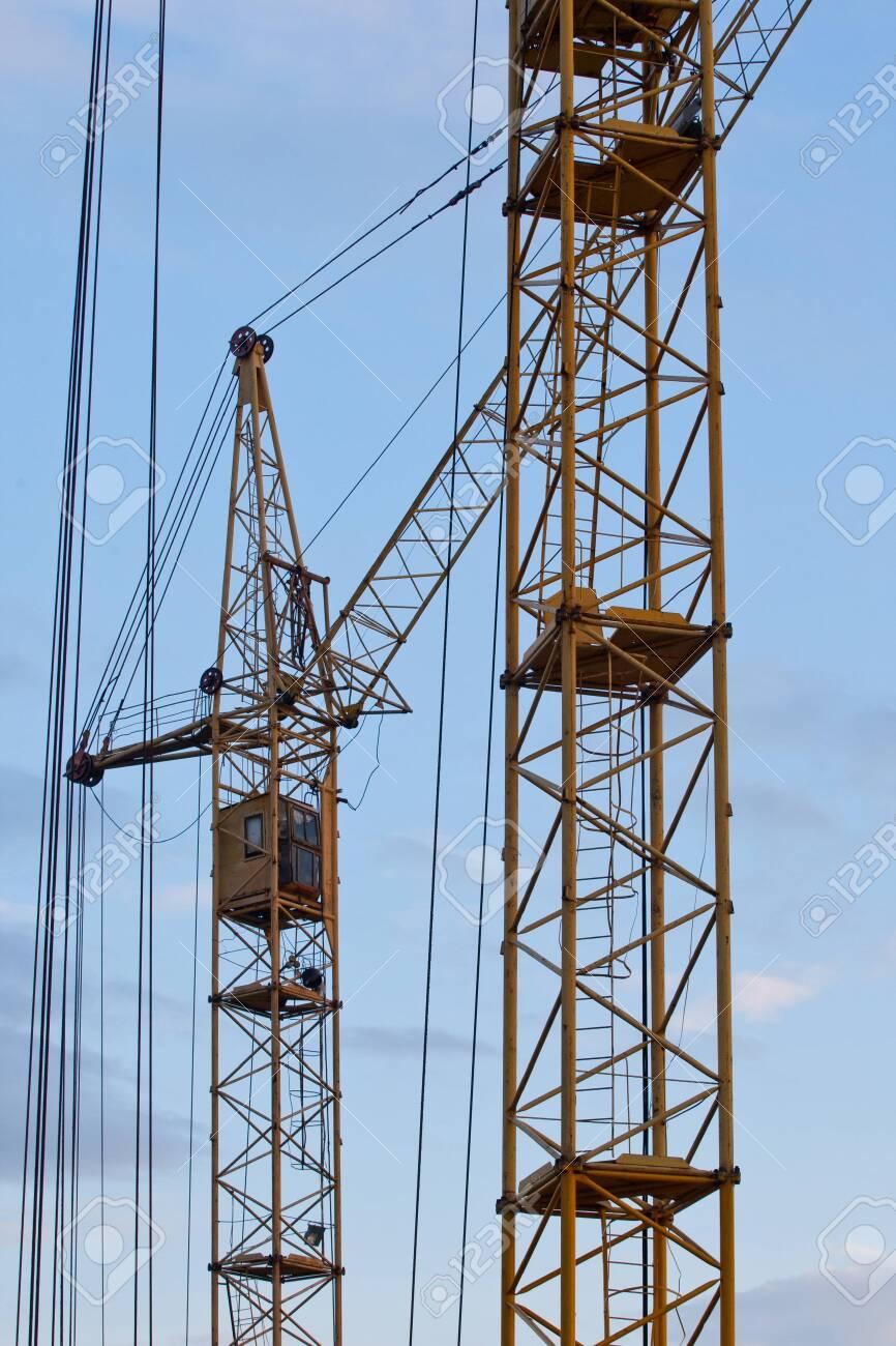 yellow building tower crane
