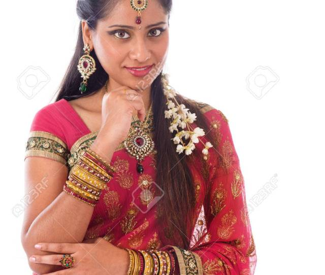 Portrait Of Beautiful Young Indian Girl In Traditional Sari Dress Thinking Looking At Camera