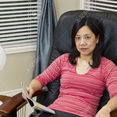 Asian Massage Chairs Philippe Starck Lady Reading Magazine While Relaxing In Chair At Home Stock Photo 12475968