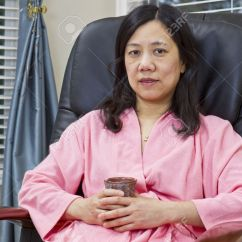 Asian Massage Chairs Office Max Lady Holding Cup Of Coffee In Bathrobe While Relaxing Chair At Home Stock