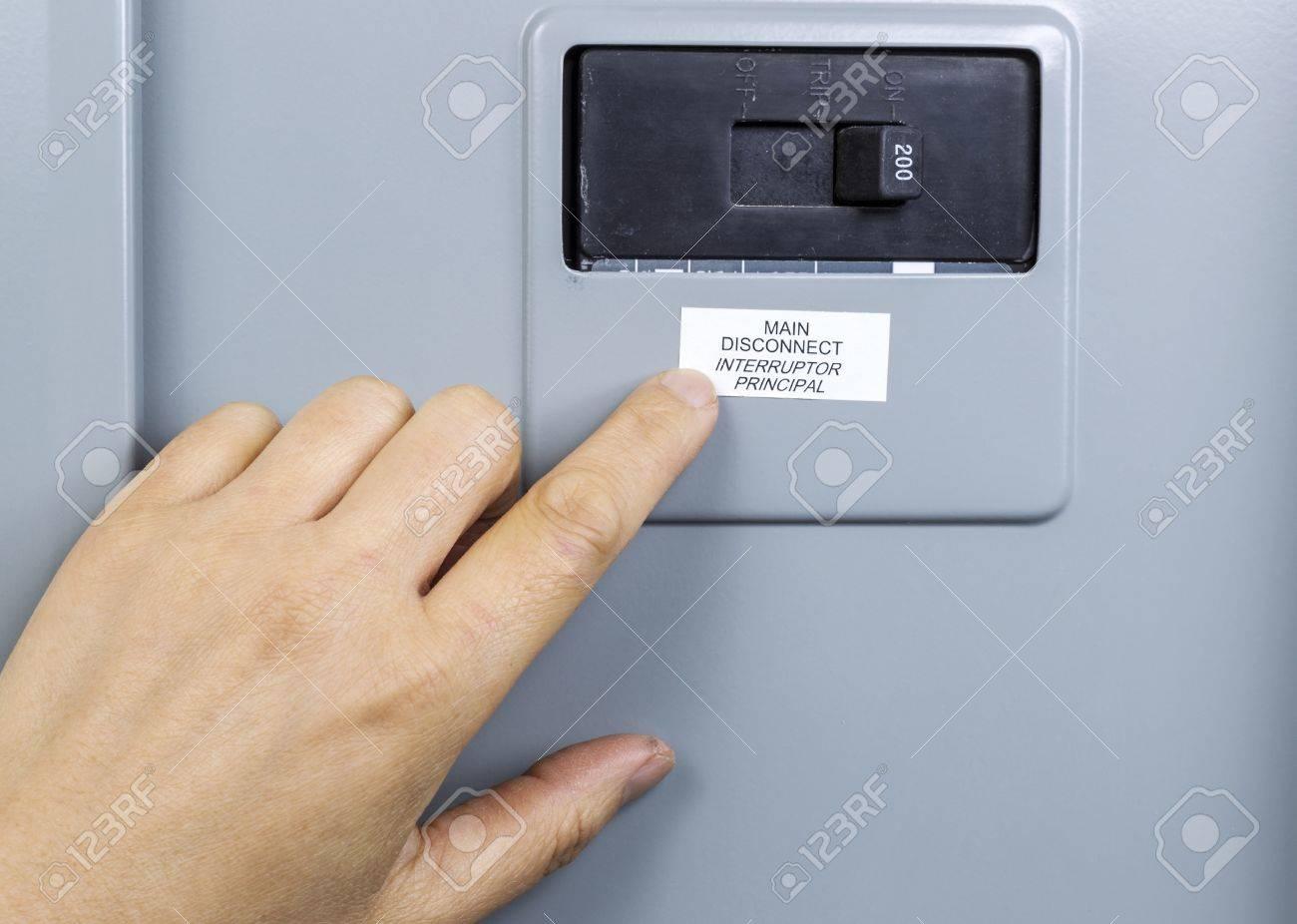 hight resolution of female hand near main circuit breaker of house power panel stock photo 16587612