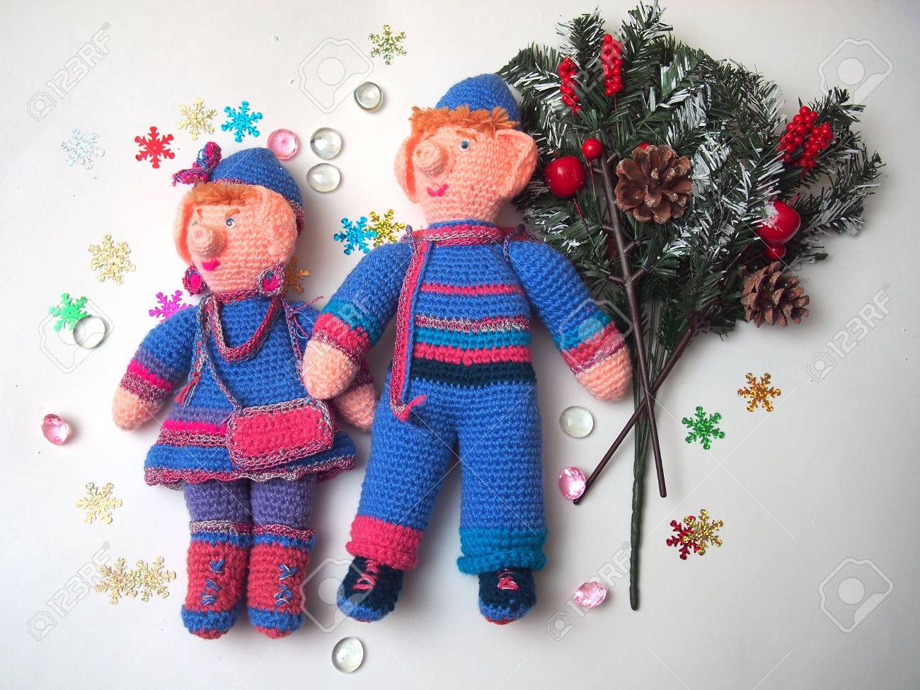 Two Handmade Dolls With Christmas Decorations Knitted Dolls Stock Photo Picture And Royalty Free Image Image 114072657