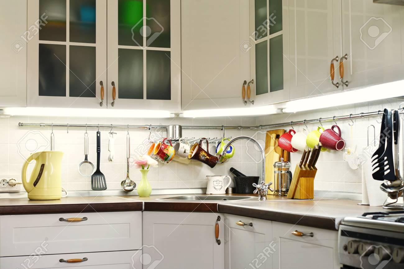 kitchen rail system clocks amazon a fragment of the scandinavian style with and utensils stock photo