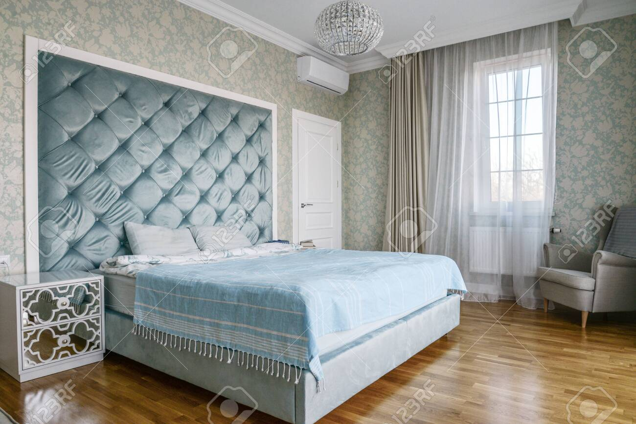 Beautiful Bedroom With King Size Bed And Soft Headboard And Armchair Stock Photo Picture And Royalty Free Image Image 122591406