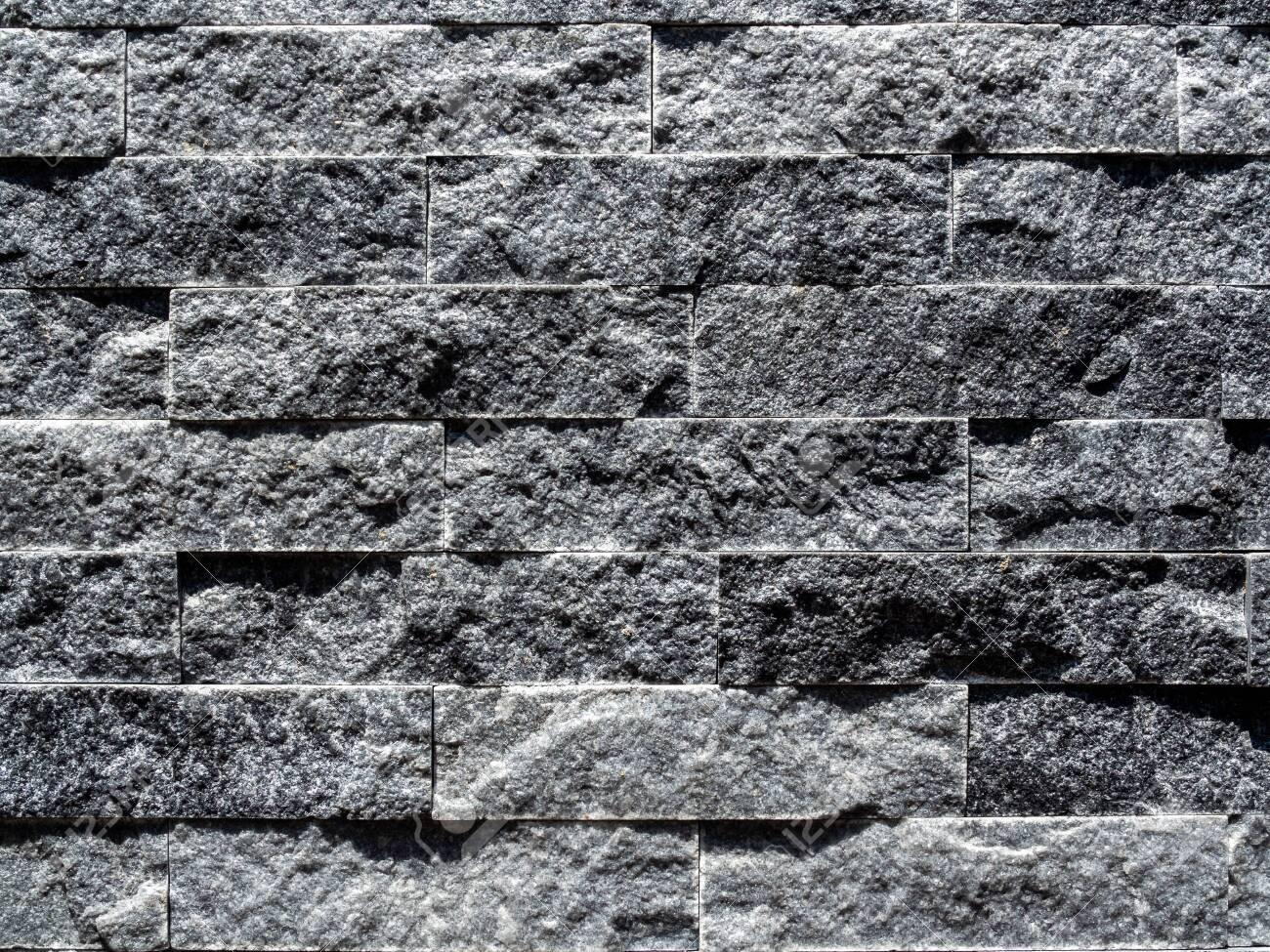 close up modern grey brick wall background grey stone brick