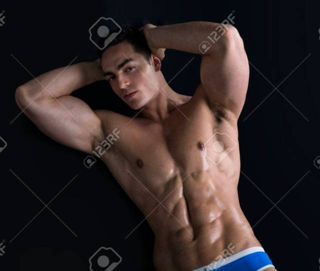 Attractive Young Man Laying On The Floor With Naked Muscular Ripped Body Hands Under Head