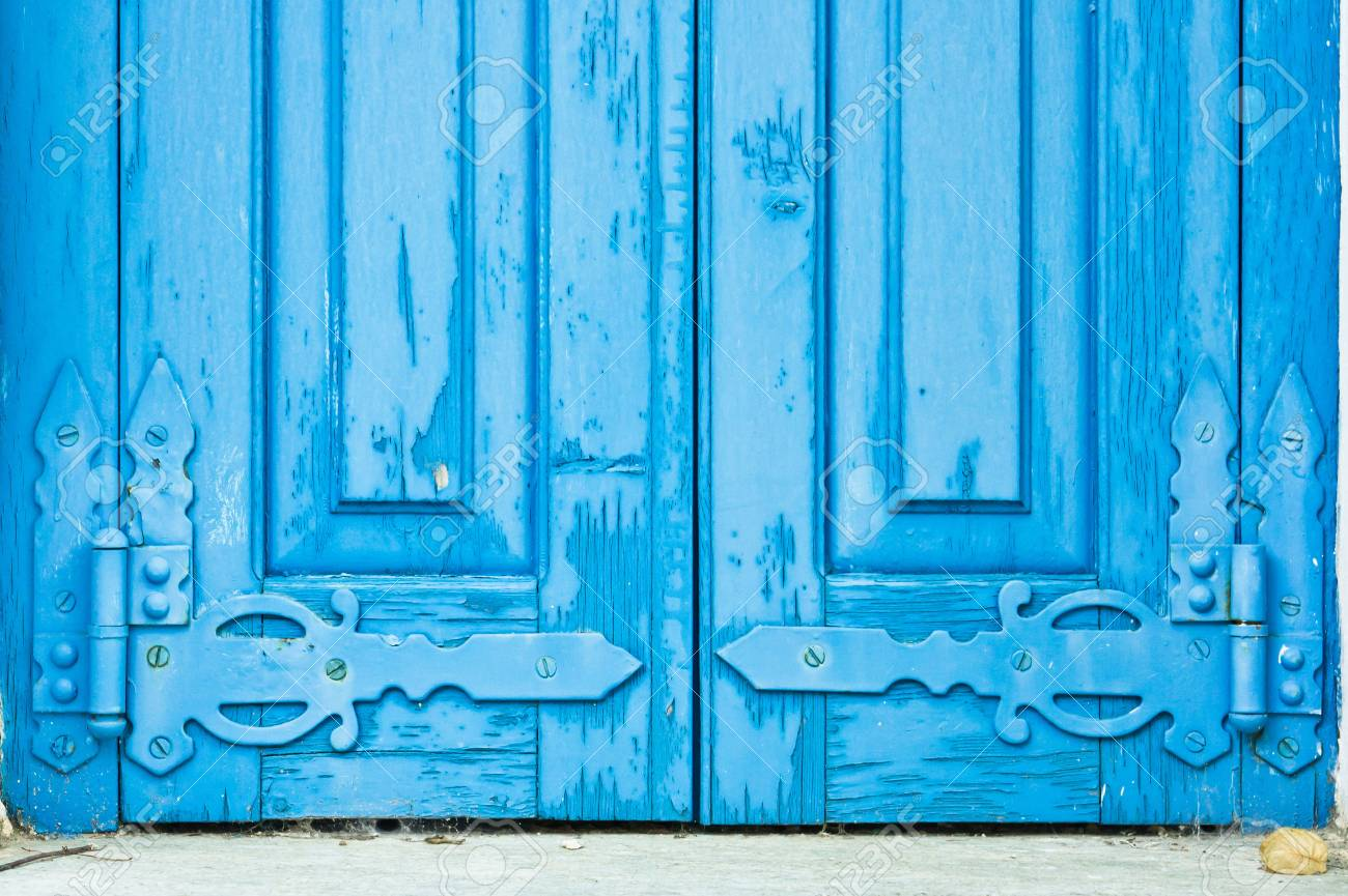 Old Blue Window Shutters With Decorative Hinges