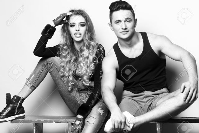 Stock Photo Young Couple Of Muscular Boy And Sexy Girl Smiling And Sitting In Studio Black And White