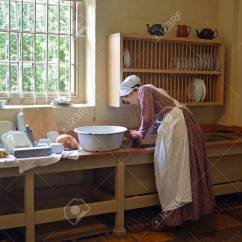 Kitchen Maid Distressed Wood Table Victorian Washing Dishes In Sink Stock Photo Picture