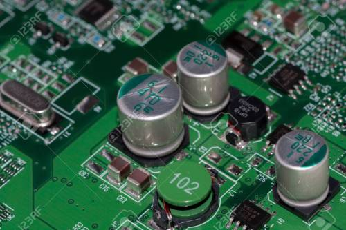 small resolution of stock photo sub system mounted on a printed wiring board with integrated circuits electrolytic capacitors chip capacitors smd chip resistors smd