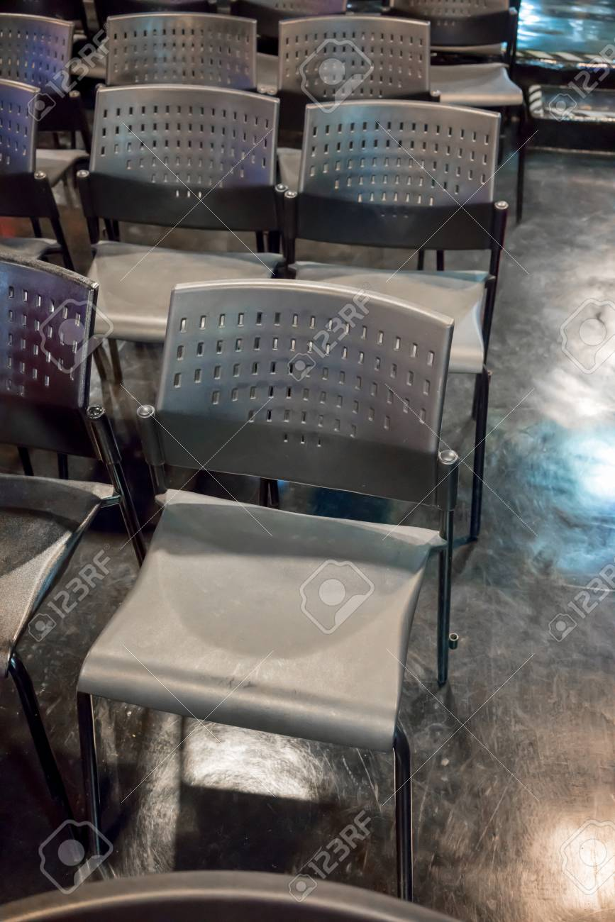 plastic chairs with stainless steel legs swing chair rona rows of grey metal arranged on shiny floor in exhibition