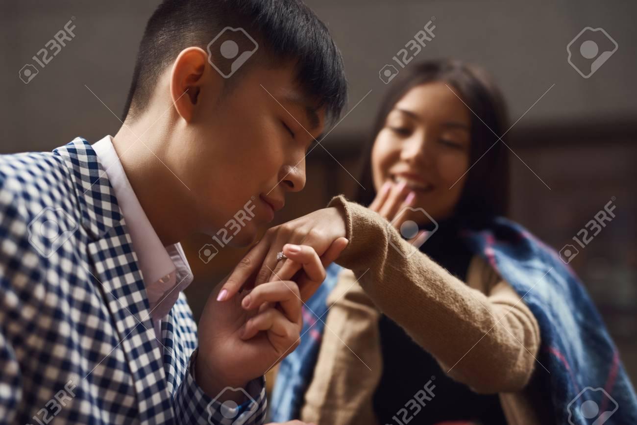 guy kisses hand of
