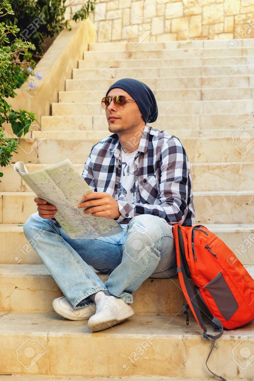 Young Tourist On Vacation Looks At The City Map Stock Photo Picture And Royalty Free Image Image 56017537
