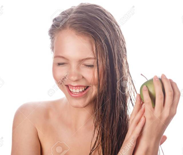 Portrait Of A Teen Girl With Nude Makeup And Clean Skin A Girl Holding A
