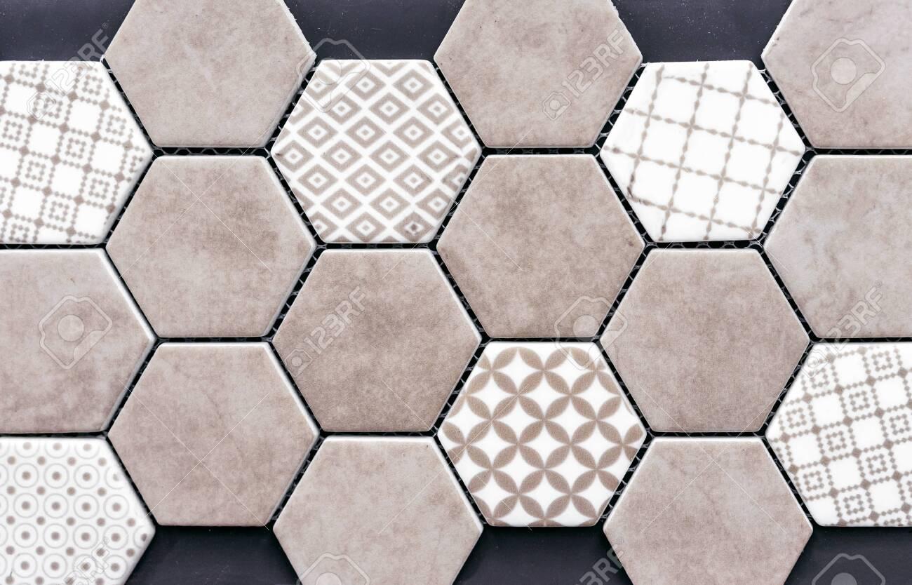 beige ceramic tile in the form of honeycombs hexagonal floor