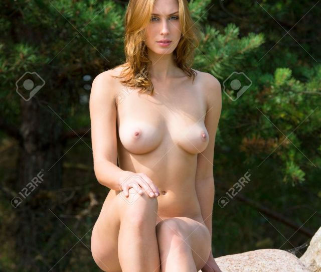Beautiful Nude Woman Posing On Stones Against Nature Background Stock Photo 21374208