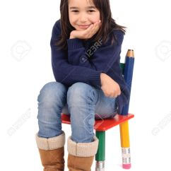Little Girl Chairs Adirondack Target Sitting In A Chair Stock Photo Picture And Royalty Free 18056166