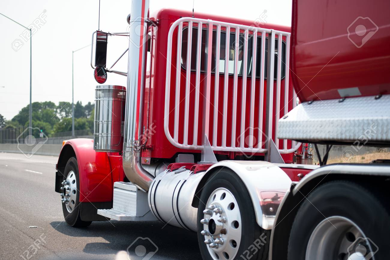 stylish classic powerful red big rig semi truck with chrome vertical