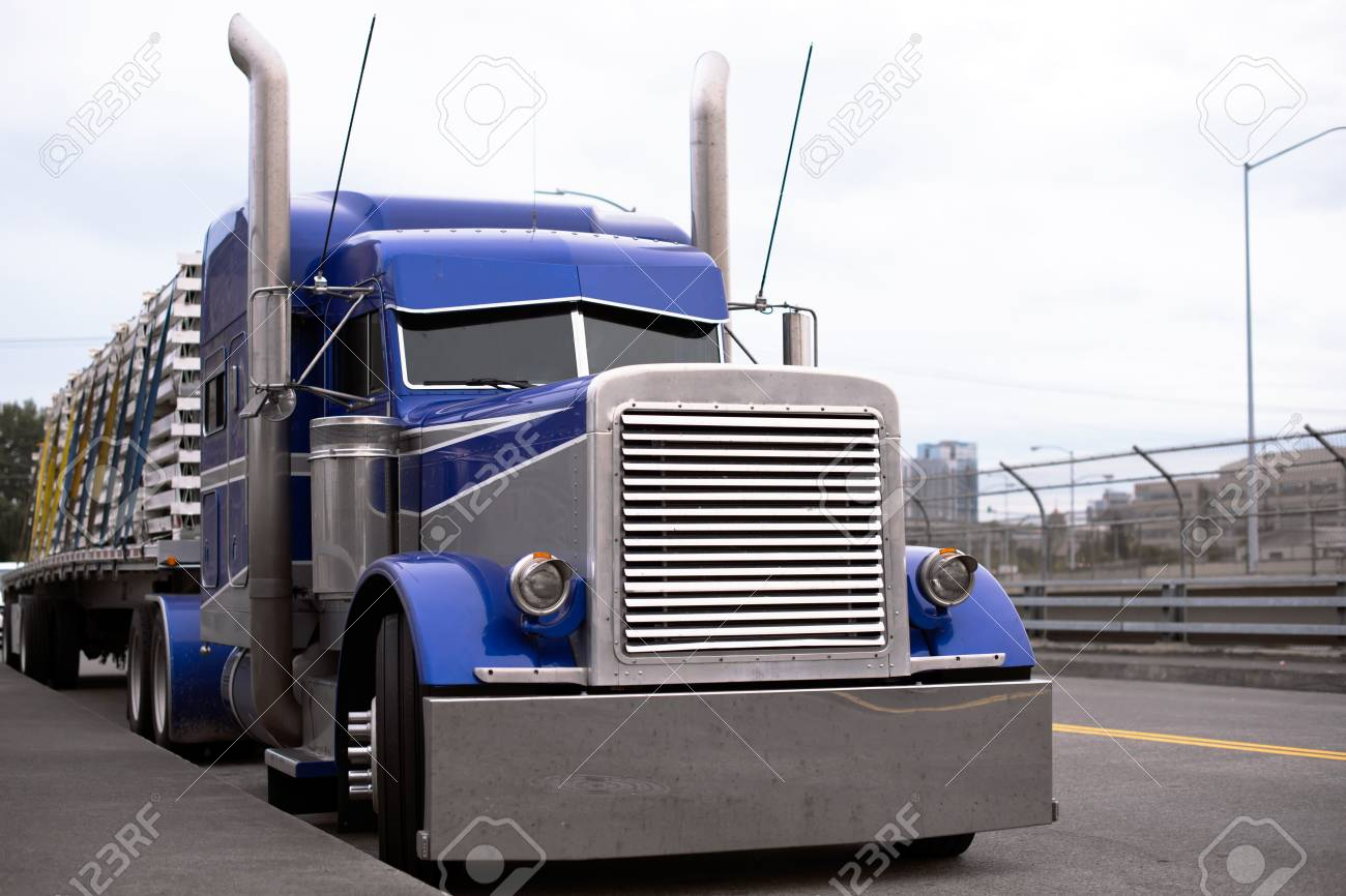 face of blue american classic popular powerful big rig semi truck