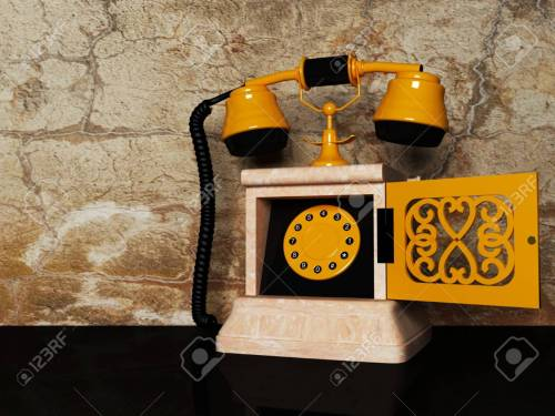 small resolution of old antique phone on the original background stock photo 12867513