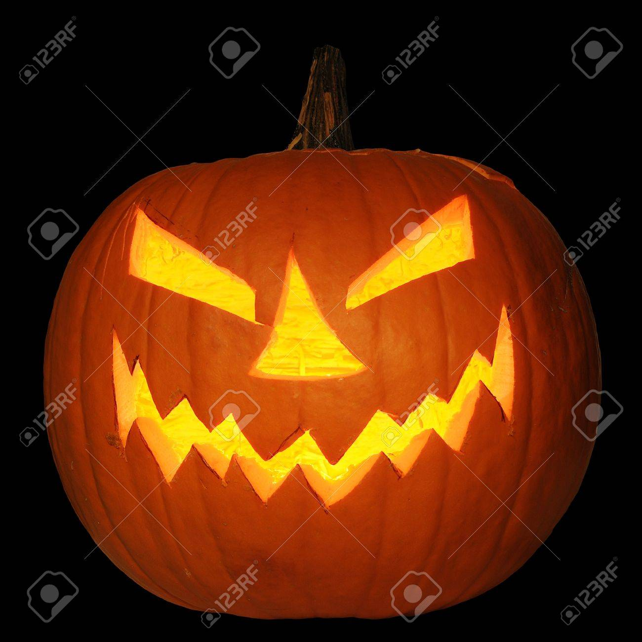 Scary Halloween Pumpkin Jack O Lantern Candle Lit Isolated On Stock Photo Picture And Royalty Free Image Image 8307502