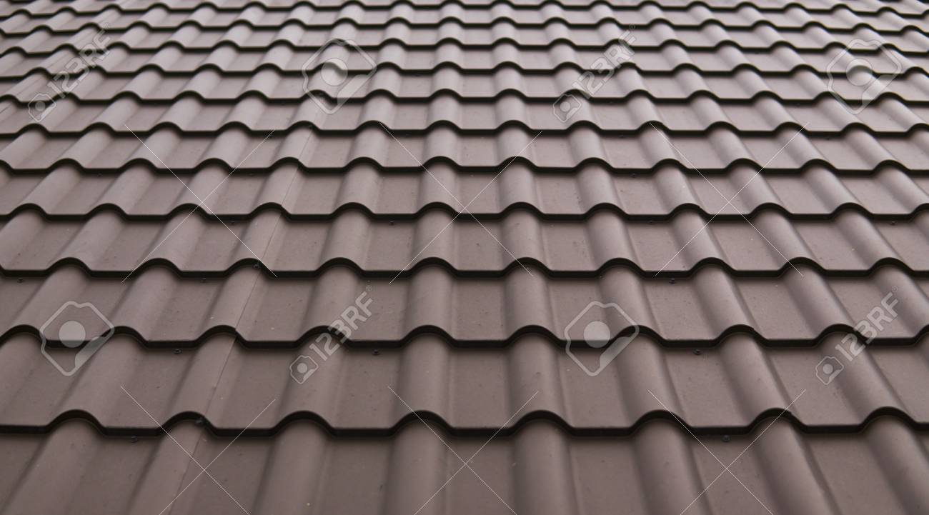 modern roof covered with tile effect pvc coated brown metal roof
