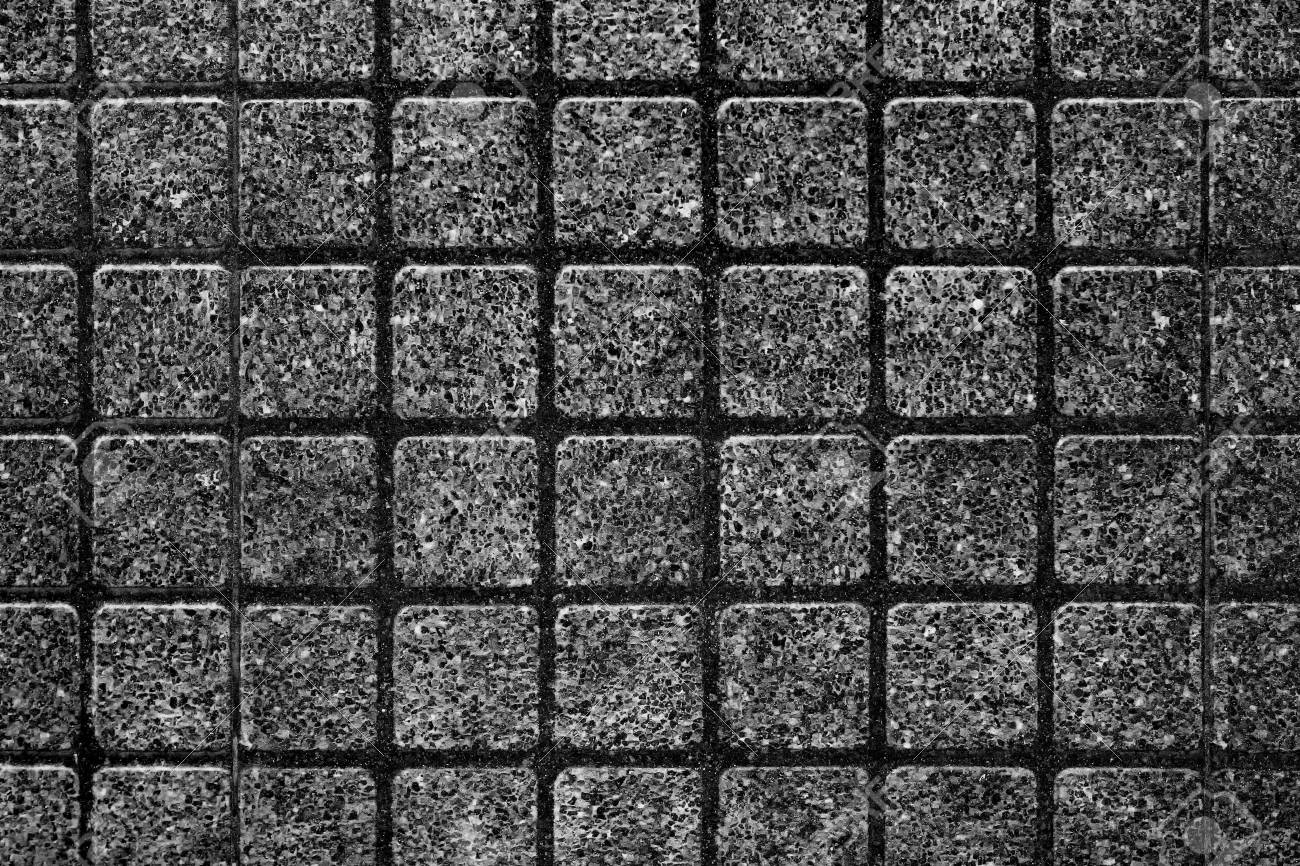 outdoor black square stone block tile wall background and texture