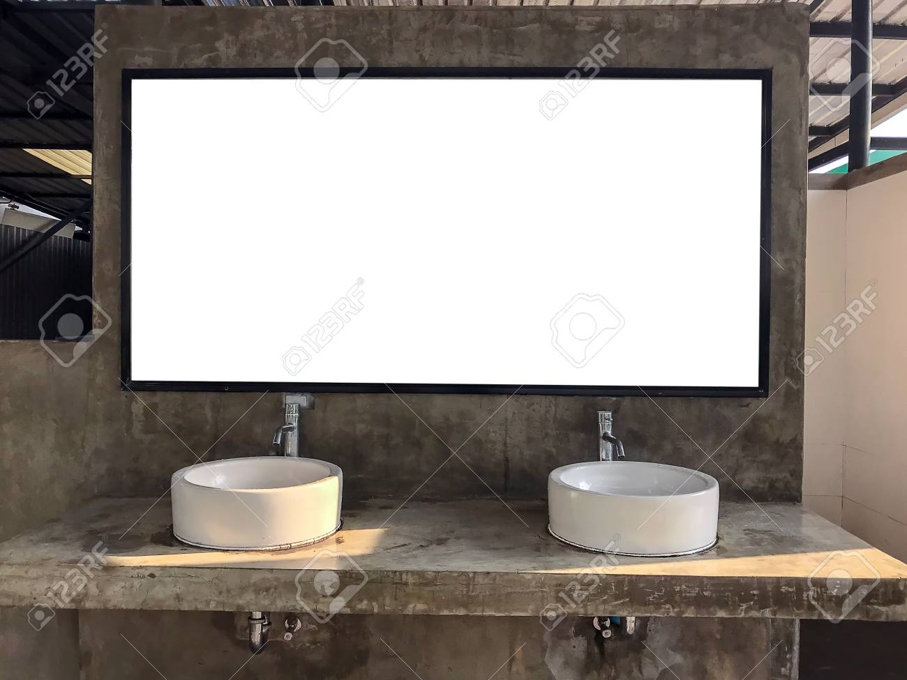 ceramic basins and mirrors on bare cement are popular public