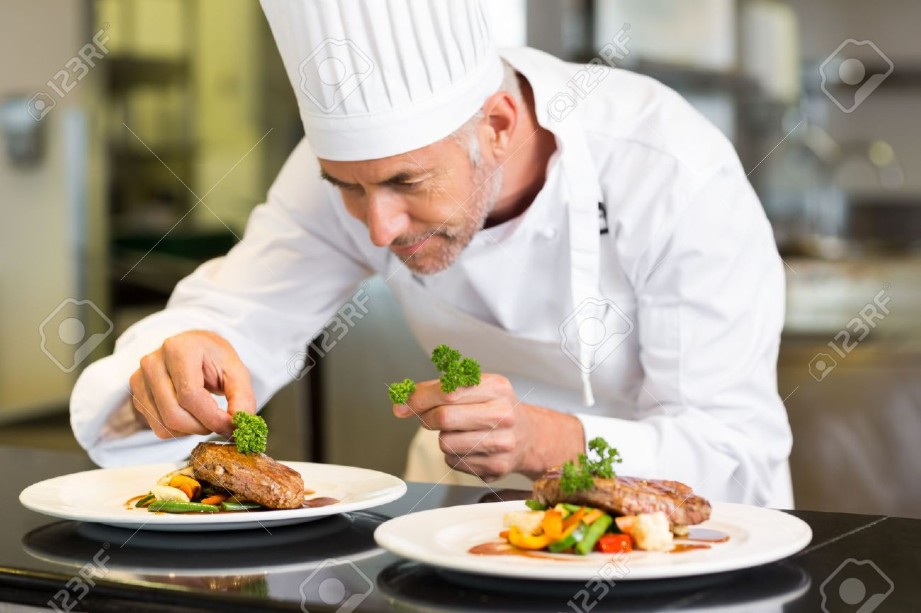 kitchen chief 3 piece faucet closeup of a concentrated male chef garnishing food in the stock photo 27150722