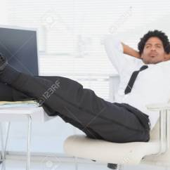 Swivel Chair Feet Slingback Beach Chairs Businessman Relaxing In His With Up Stock Office Photo 30885738