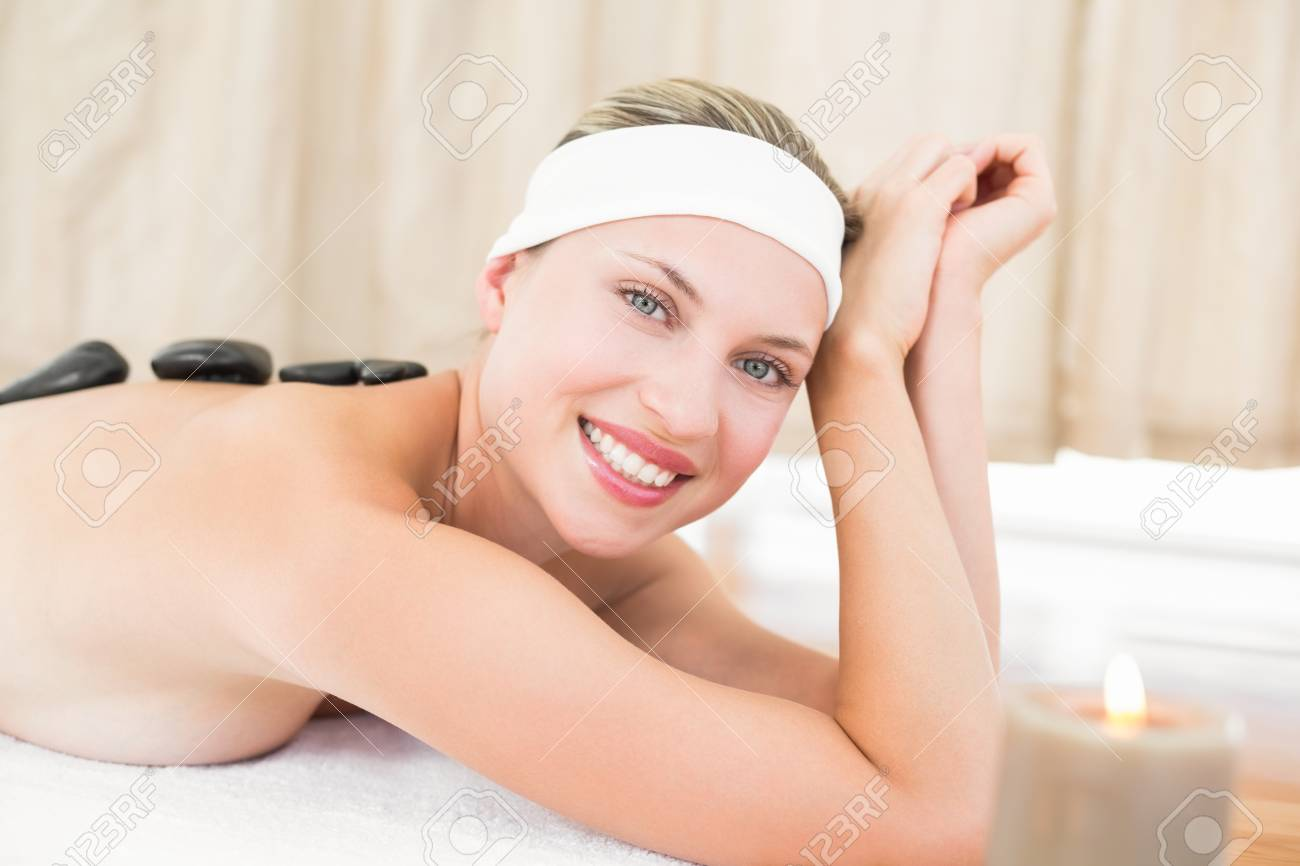 Beautiful Blonde Enjoying A Hot Stone Massage At The Health Spa Stock Photo 42399897