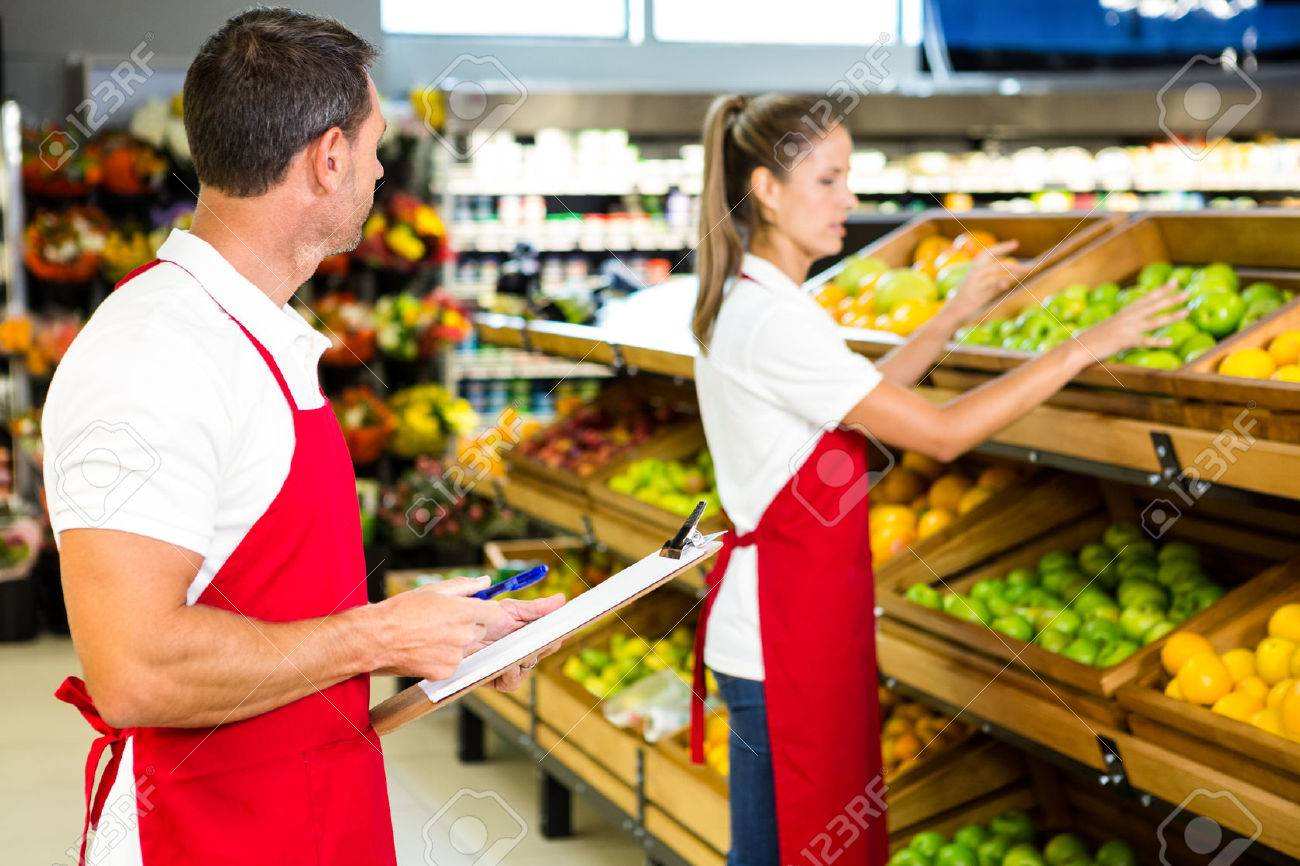 grocery store staff with