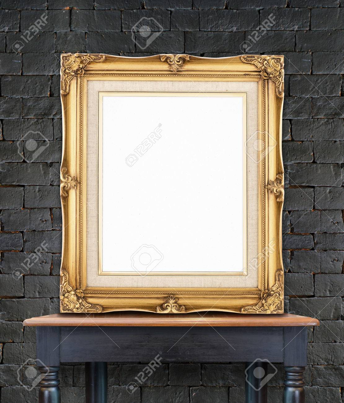 Blank Vintage Golden Photo Frame Lean At Black Brick Wall On.. Stock ...